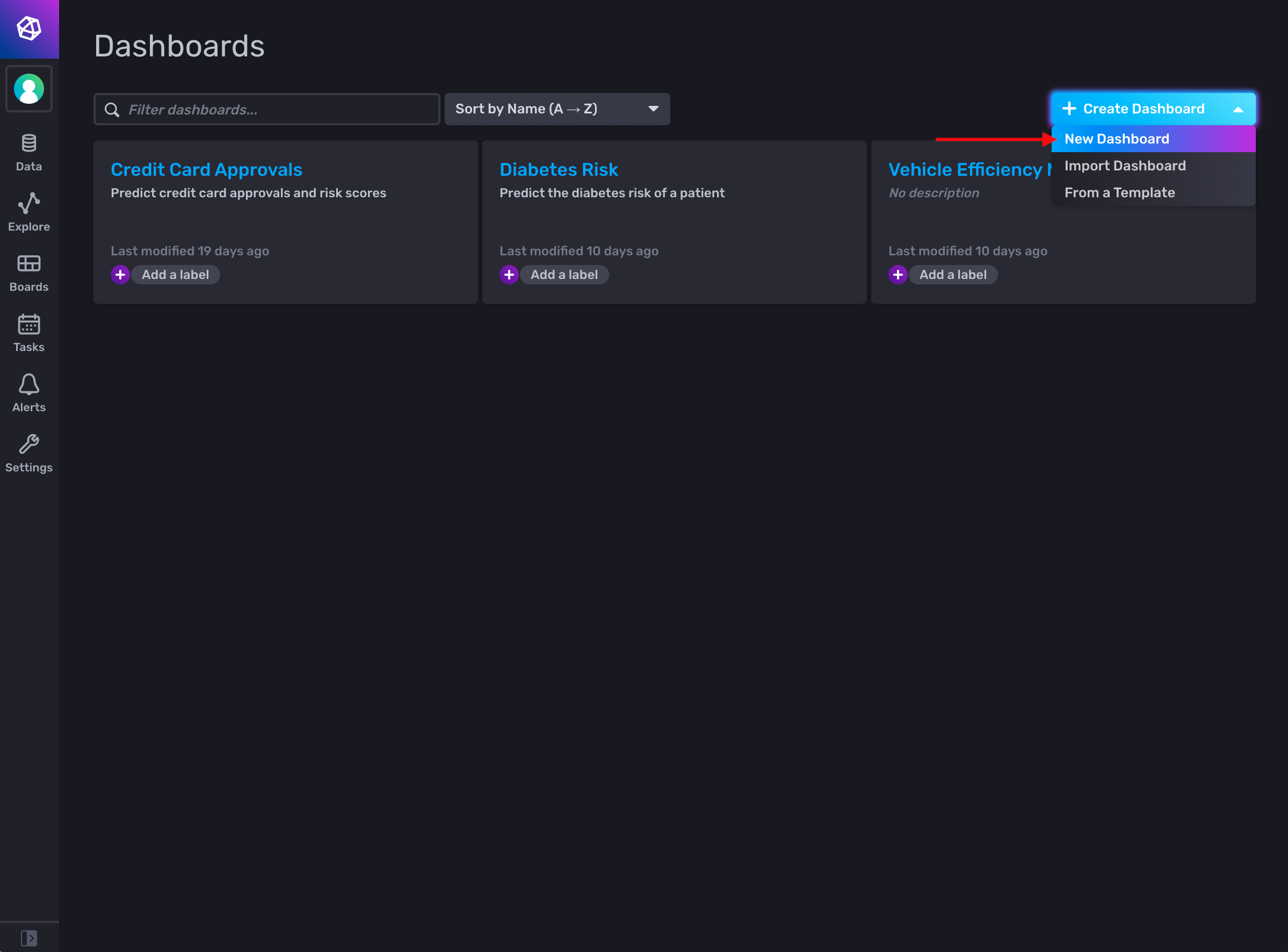 InfluxDB Dashboards page with arrow pointing to new dashboard drop-down